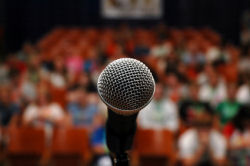 public-speaking-phobia-microphone-blurry-audience-conference-speaker